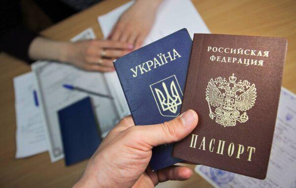 LUGANSK, UKRAINE - APRIL 29, 2019: A person holds passports of the Russian Federation and Ukraine at a centre for issuing Russian passports to residents of the Lugansk People's Republic (LNR); located in east Ukraine, the self-proclaimed Lugansk People's Republic has been in military conflict with the government of Ukraine since 2014; on 24 April 2019, the President of Russia signed a decree to simplify the procedure for obtaining Russian passports for residents of Ukraine's Donetsk Region and Lugansk Region. Alexander Reka/TASS  Óêðàèíà. Ëóãàíñê. Ïàñïîðòà Óêðàèíû è ÐÔ â öåíòðå âûäà÷è ïàñïîðòîâ ÐÔ æèòåëÿì ËÍÐ. 24 àïðåëÿ ïðåçèäåíò ÐÔ Âëàäèìèð Ïóòèí ïîäïèñàë óêàç, ïîçâîëÿþùèé æèòåëÿì Äîíåöêîé è Ëóãàíñêîé íàðîäíûõ ðåñïóáëèê ïîëó÷èòü ðîññèéñêîå ãðàæäàíñòâî â óïðîùåííîì ïîðÿäêå. Àëåêñàíäð Ðåêà/ÒÀÑÑ