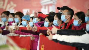 (200128) -- YINCHUAN, Jan. 28, 2020 (Xinhua) -- Members of a medical team are seen on a ceremony before their departure to Wuhan of Hubei Province, at the Hedong International Airport in Yinchuan, northwest China's Ningxia Hui Autonomous Region, Jan. 28, 2020. A team comprised of 135 medical workers from Ningxia left for Wuhan on Tuesday to aid the novel coronavirus control efforts there. (Xinhua/Wang Peng)